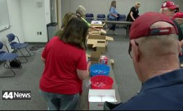 Volunteers Pack Supply Bags Before Honor Flight