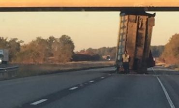 Westbound I-64 Closed to Remove Wedged Dump Truck Trailer