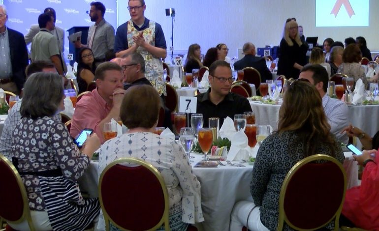 Local Celebrities Serve Dinner For Families Impacted By HIV/AIDS